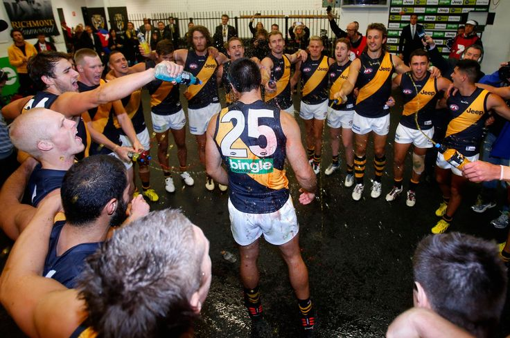 The Tigers belt out the song after last night's win over the Blues. Credit: Richmond FC