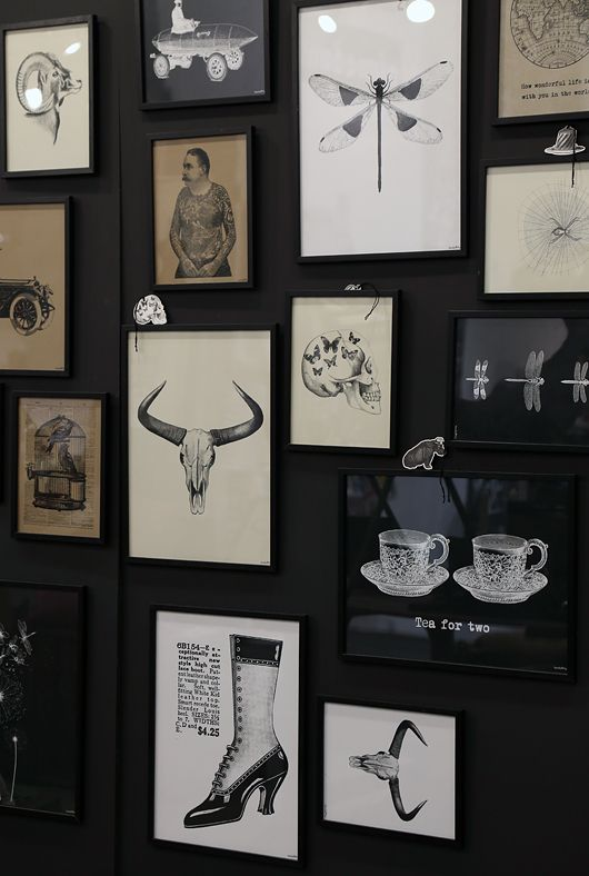 Great dark grey/ charcoal wall color and collection of prints. Skull with butterflies also comes printed white on black.