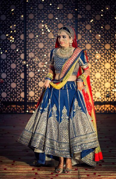 Bridal Lehengas - Royal Blue Sabyasachi Lehenga with Silver Tribal Embrodery and Red and Yellow Net Dupatta | WedMeGood #wedmegood #bridal #Lehengas