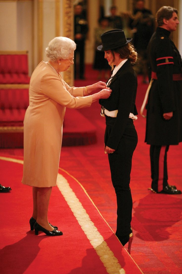Alice receiving her MBE from Her Majesty The Queen