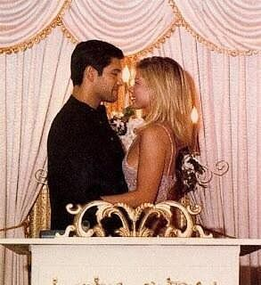 The Ultimate Celebrity Wedding Gallery: Kelly Ripa and Mark Consuelos ran away to Las Vegas for their May 1996 nuptials.  Source: Twitter user KellyRipa