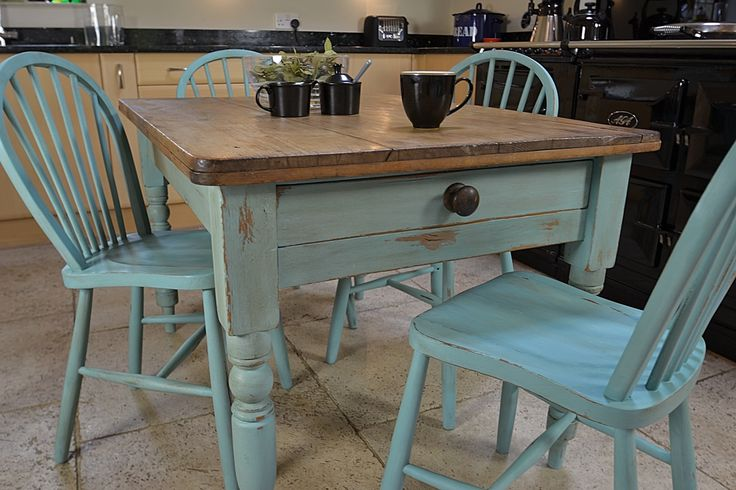 This rustic shabby chic dining table with drawer, comes with four stickback chairs and is painted in an Annie Sloan Provence & Old White mix. Bring some country charm and brightness into your kitchen