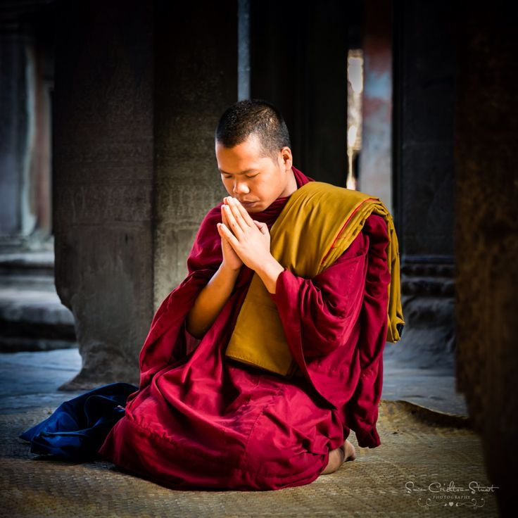 Praying Monk Early morning prayers at Angkor Wat Temple in Cambodia ~ Susan Crichton-Stuart