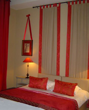 Love the idea of hanging curtains behind the bed, just with different curtains/color scheme.