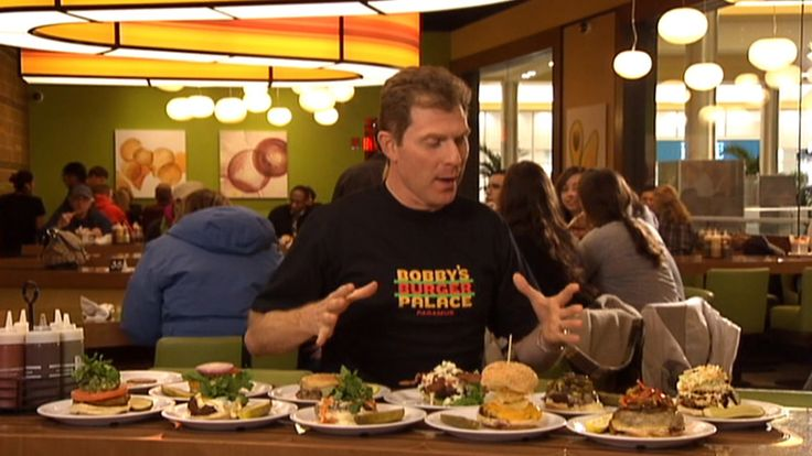 "Bobby Flay shows you around his Burger Palace restaurant, while offering clues as to what he's looking for as judge in his ""Burger Battle"" to choose a new cook's recipe to feature on his menu!  12-30-13"