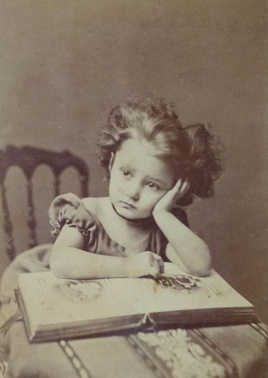 lauramcphee:  Girl with photo album, c1870s (Source) via thehystericalsociety