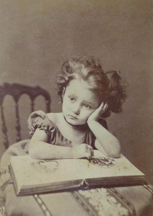 Girl with photo album, circa 1870