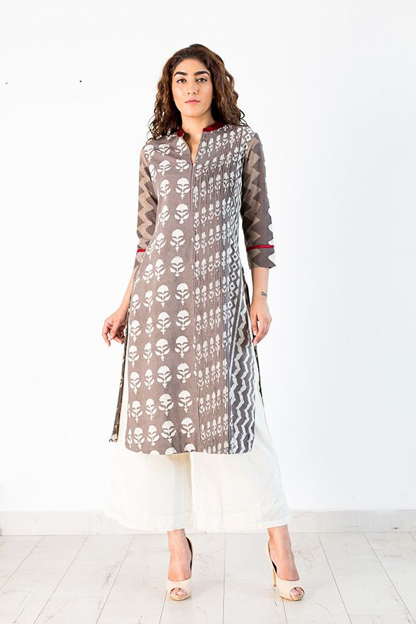 A classic long straight kurta with two different block print design for the front and back creates an interesting detail and Elegance. Fine hand made Jali & tucks on the neck and side front with silk mashru bright crimson red Chinese collar speaks of fine craftsmanship in its creation ! Elegance redefines itself with this Ensemble. Team it up with kora Farshi pants/ Culottes to create an urban Chic look , Wear it for office or an evening with friends , it's just right for every occasion .