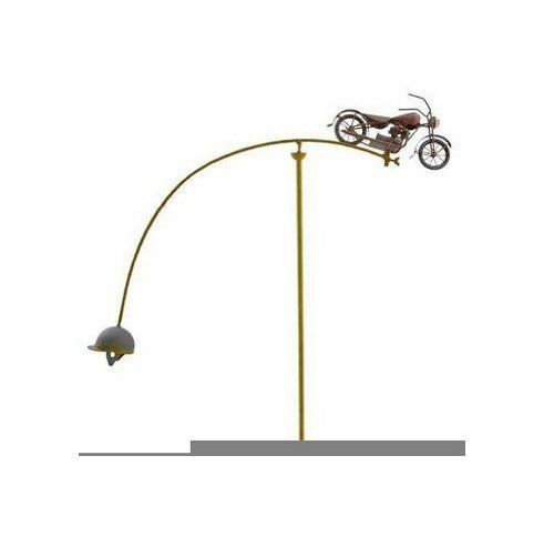 Red Carpet Studios 34209 52-Inch Balancing Buddies Yard Art, Motorcycle by Red Carpet. $49.99. Unit is 22-inch wide by 51-3/4-inch tall, perfectly balanced to spin and seesaw in the slightest breeze,. Balancing buddies yard art is a unique sculpture that adds a whimsical touch to any home, walkway or garden. Features an old fashioned motorcycle complete with headlight on one side with an opposing metal helmet at the other end. Metal icons with a rustic finish. Easily inserts int...