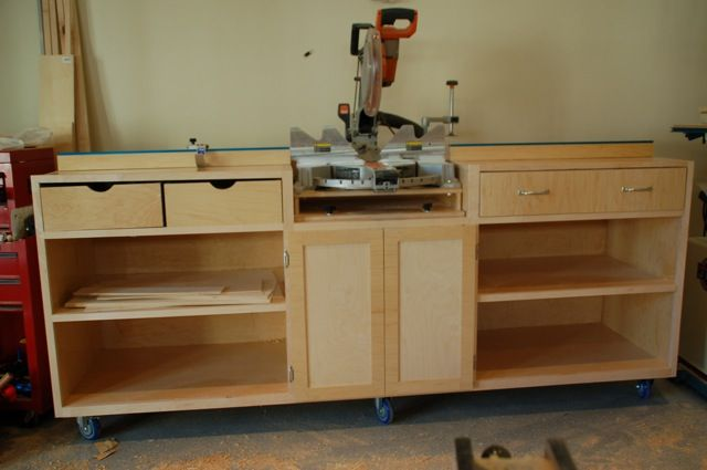 Full miter saw stand and cabinet. If only I had this much room to have ...