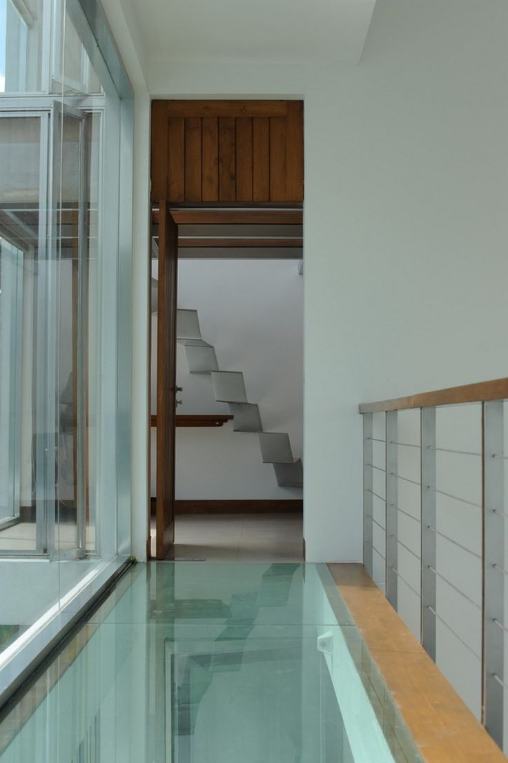 Synergy great room window wall modern family room - Fascinating Home Design For Modern Family Brilliant Hallway Interior With Glass Flooring Design In Modern Residence Home Narrow Hallway Des