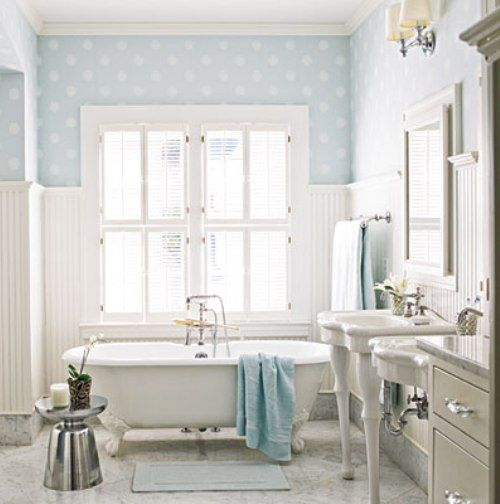 Subtle blue and white polka dot walls in the bathroom. >> What a sweet bathroom!