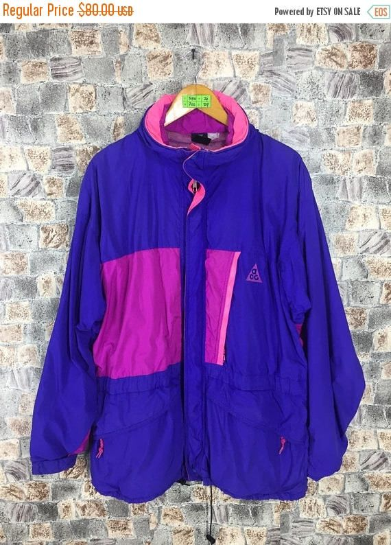 NIKE ACG Multicolour Windbreaker Large 90s Nike Swoosh Neon Multicolour Sportswear Vintage Sport Trainer Nike Ski Wear Hoodie Jacket Sze L  Tag reads:  None but fits like Size L (check measurements below)  Measurements: Width (armpit to armpit): 24 Length (shoulder to end of garment): 29  All measurements are taken with the garment flat on the ground.  Condition: Good Condition. No holes and stains,  ** WE ARE USING DHL EXPRESS, IT TAKES 3-5 DAYS ONLY TO ARRIVE. PLEASE LEAVE YOUR PHONE…