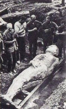 "The fossilized Irish giant from 1895 is over 12 feet tall. The giant was discovered during a mining operation in Antrim, Ireland. This picture is courtesy ""the British Strand magazine of December 1895"" Height, 12 foot 2 inches; girth of chest, 6 foot 6 inches; length of arms 4 foot 6 inches. There are six toes on the right foot"
