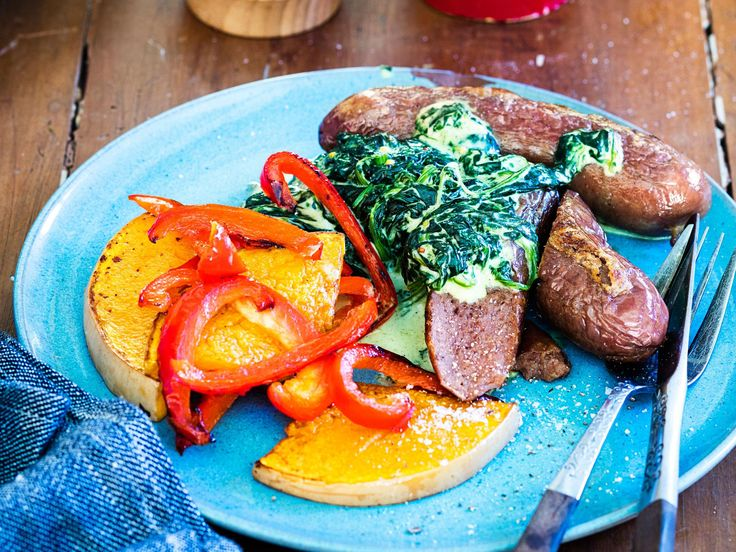 Baking sausages slowly is a no-fuss way of getting dinner cooked. Bang them in the oven with some pumpkin wedges and red capsicum, and you can get on with whipping up a batch of creamed spinach