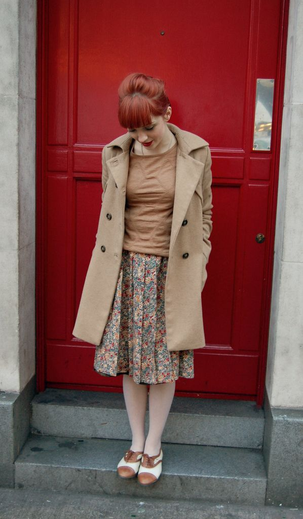 Tan sweater, flower patterned skirt, sheer white tights, tan & white oxfords, tan coat -Yours Truly, x