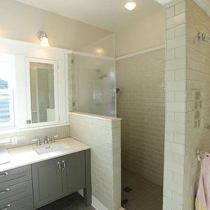 Cream tiles, grey cabinetry, white trim