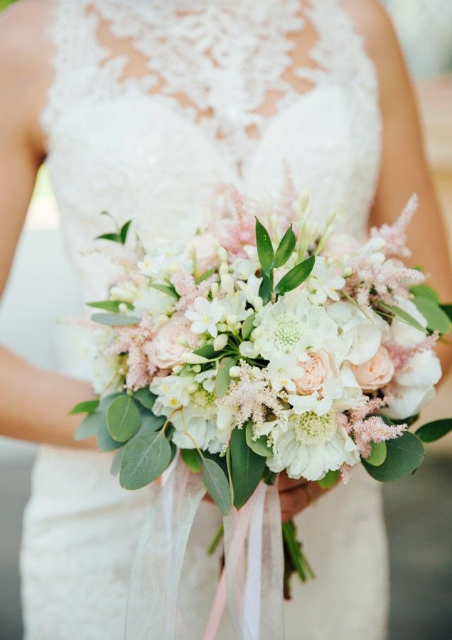 Soft wedding bouquet in blush, light pink and white flowers.