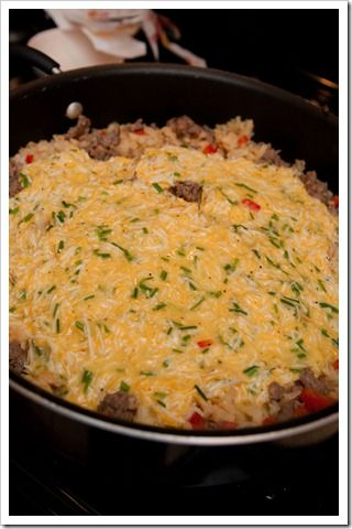 1 lb. sausage {we used Jimmy Dean…HOT!}  1 bag frozen hash brown potatoes  2 red bell peppers, seeded & chopped  10 eggs  1 tsp. seasoned salt {we used Lawry's}  black pepper, to taste  1/4 cup half & half  2 tbsp. chives, chopped  2 cups shredded cheese {we used colby & monterrey jack  1 lb. bacon, cooked & chopped
