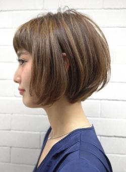 Heavier bob haircut with puff styling