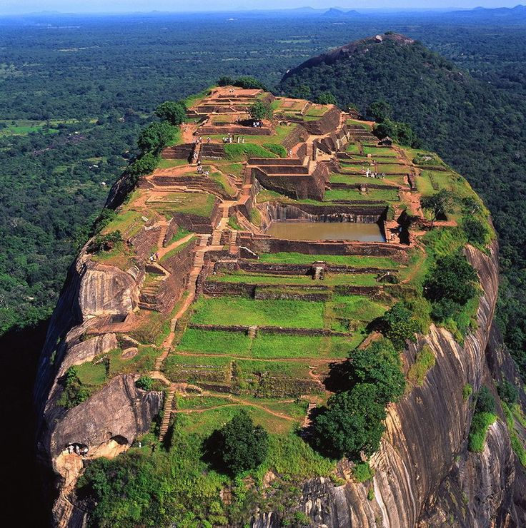 Sigiriya, Sri Lanka. Sigiriya (Lion Rock) is an ancient palace located in the central Matale District near the town of Dambulla of the Central Province. The name refers to a site of historical and archaeological significance that is dominated by a massive column of rock nearly 660 feet high. (V)