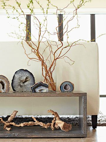 Colorful Shine:: Nature offers beauty in the most unexpected places-- in this case, with rocks. Oversize cut agates add texture & depth to a vingette or bookshelf display. Pairing these elegant natural finds with a thick, twisty tree branch & vase filled with freshly cut winding twigs adds another dimension of natural appeal & texture.