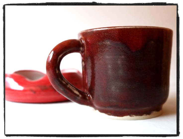 rusty-red stoneware cup & intense red ashtray