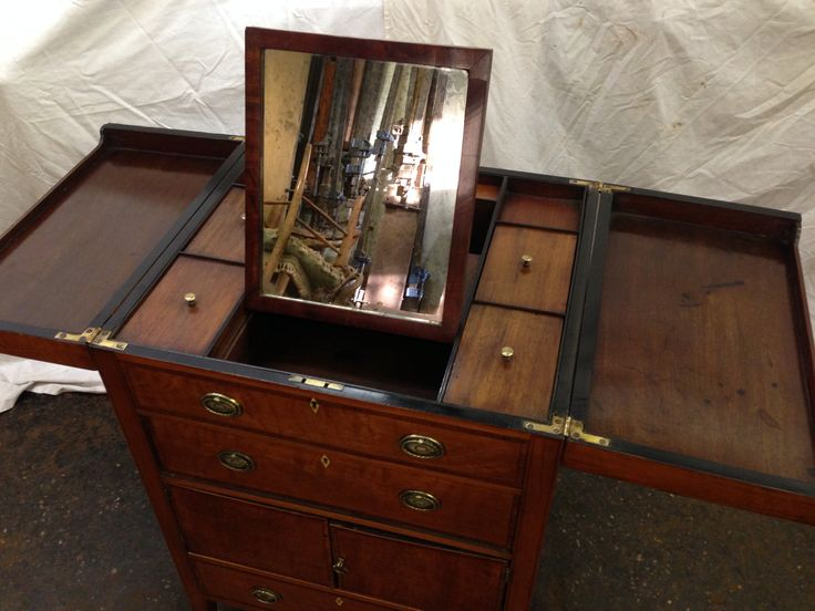 Interior of dressing chest with compartments and mirror