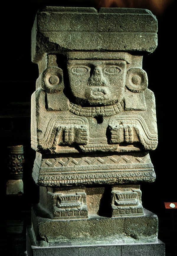 """Water Goddess; from Teotihuacán (Mexico) in the Pyramid of the Moon; c. before 600 AD; Basalt; Height 10'6""""; Aztec (Mexica; Triple Alliance); Believed to be a relief sculpture of the water goddess, Chalchiuhtlicue. It is a caryatid figure that held a central wooden roof beam."""