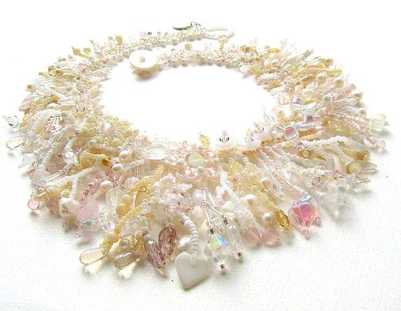 PLEASE NOTE THIS IS A MADE TO ORDER ITEM - there will be a delay of approximately 4-6 weeks between ordering and shipping.  Another in my signature Garden series, this time in a creamy champagne colourway with touches of white, pearl, peach and pale pink. This would be a perfect statement necklace for a bride and its a lovely summer necklace for special occasions.  I just love making these collars! Each one is different and I never know exactly how its going to turn out. Tiny beads are…