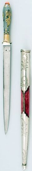 Ottoman kard dagger, 1808 to 1839, straight blade, double-edged at the top, T-shaped cross section, gray nephrite handle with gold leafy vines and flowers, inserted precious stones (amethyst, emerald and rock crystal), coral agate knob. red velvet scabbard, locket and chape of fire-gilded silver are long and with branches tied with engraved ribbons, a strong European influence, which is certainly to be regarded as characteristic of the reign of Sultan Mahmud II. Dresden State Art…