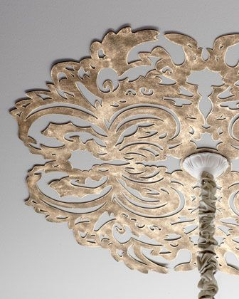 "Lace Pattern Ceiling Medallion - Metal is cut into a lace pattern and hand painted for a gorgeous antiqued finish, adding enchanting character that instantly draws the eye upward.•Handcrafted of sheet metal.  •Hand-painted light burnished-gold finish.  •Six pre-drilled holes for attaching to ceiling; hardware not included.  •32""Dia. x 0.25""D."
