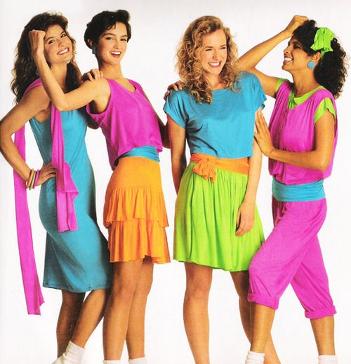 These girls are wearing outfits that are simple in design but bold and bright in color. These neon colors are lively and energetic. Neon was trendy in the 1980s. ~Maria 4/25/17