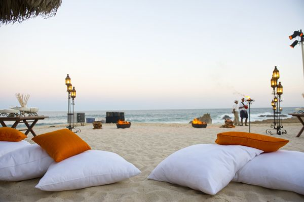 lounge - fluffy pillows: mostly white with a little peach + navy    tiki torches - party store!