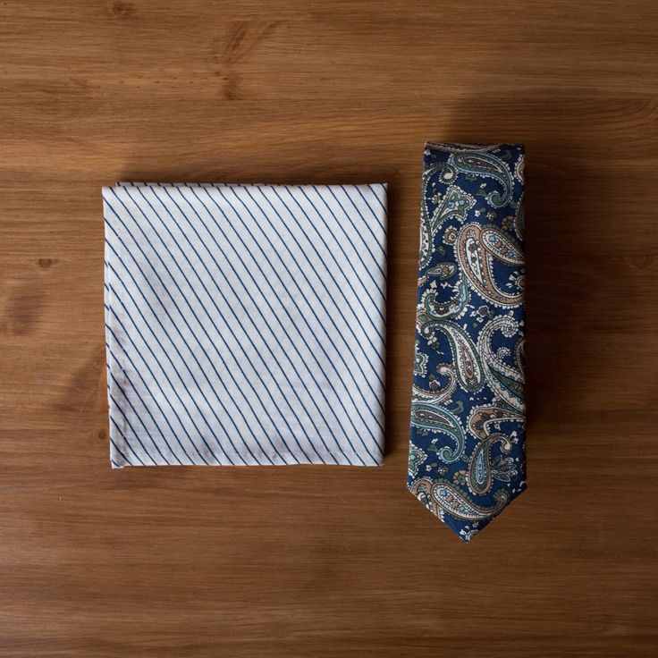 New to the shop today - a classic navy paisley necktie. It's made from cotton, and is a slim width.