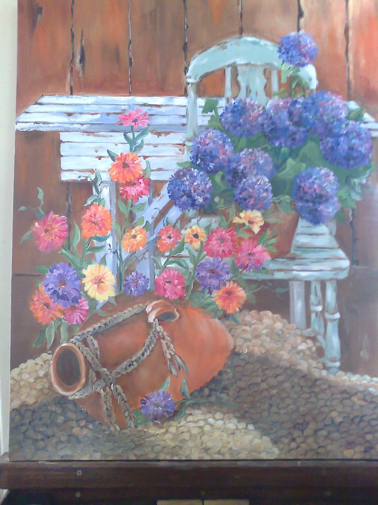 Rustic chair, table, flowers and urn