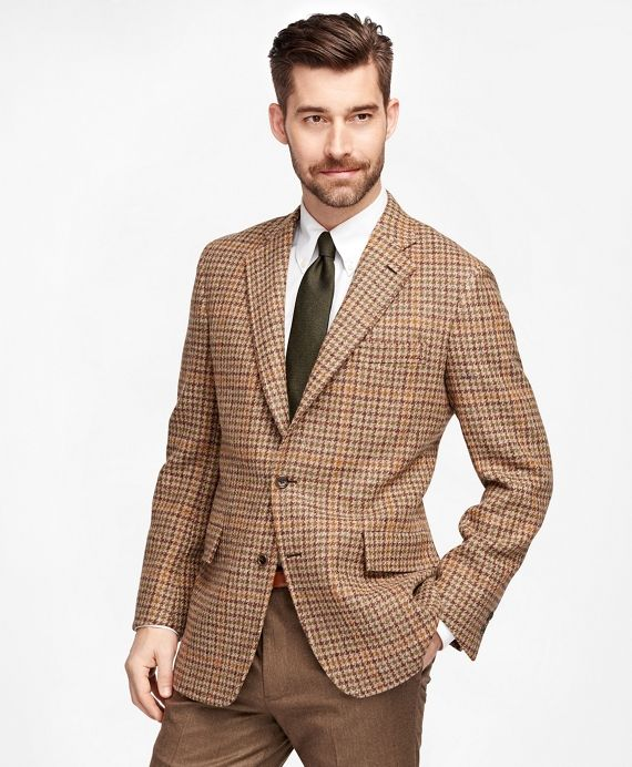 Brooks Brothers Own Make Harris Tweed Check Sport Coat. Three-button sack model, undarted with a center vent. Details include natural shoulder, hook vent and 5/16 top stitching.