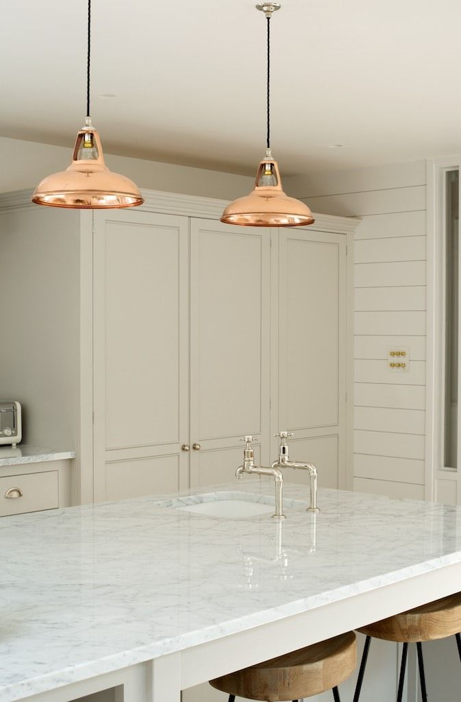 Calm kitchen design with white marble, cooper lamps and white cabins | home decor inspiration