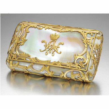A RARE FABERGÉ MOTHER-OF-PEARL CIGARETTE CASE WITH TWO-COLOUR GOLD MOUNTS, WORKMASTER MICHAEL PERCHIN, ST PETERSBURG, CIRCA 1890 Estimate: 50,000 - 70,000 GBP  LOT SOLD. 457,250 GBP  (Hammer Price with Buyers Premium) in rococo taste, the lid applied with gold cipher WA for Grand Duke Vladimir Alexandrovich, the whole overlaid with gold scrolls and flowers, the ends with trellis pattern, silver-gilt interior.  From the Romanov Heirloom sale at Sotheby's.