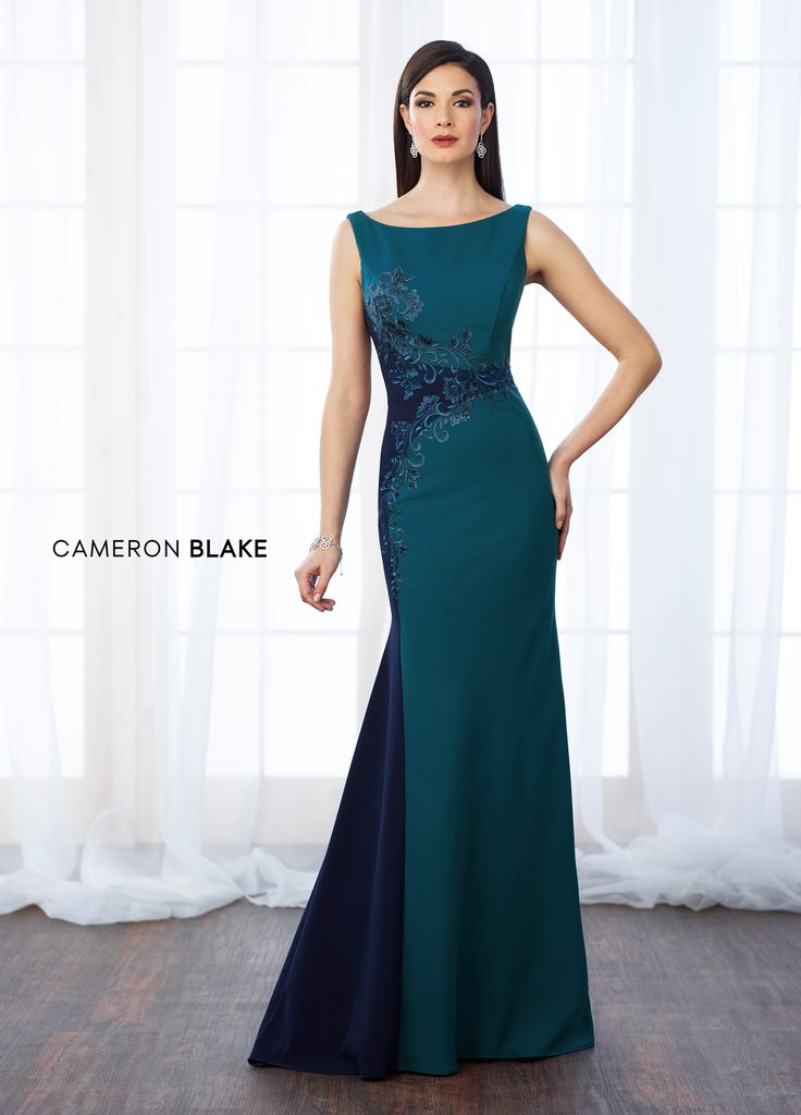 Cameron Blake 217651 - Sleeveless crepe and lace fit and flare gown with bateau neckline, V-back, lace trims color block through natural waist and down right side of gown, sweep train. Matching shawl included.