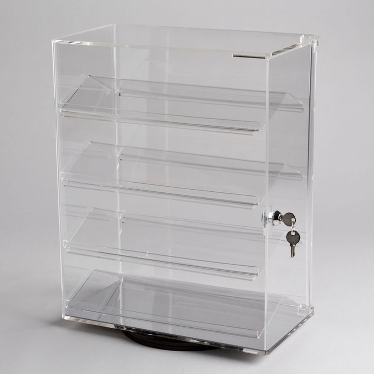 Acrylic Counter Top Revolving Display Case with lock and 4 angled shelves. Perfect for securely displaying jewelry.