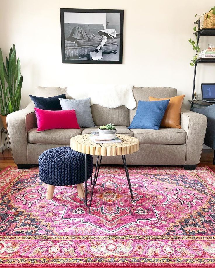 neutral sofa with colorful mismatched pillows and rug