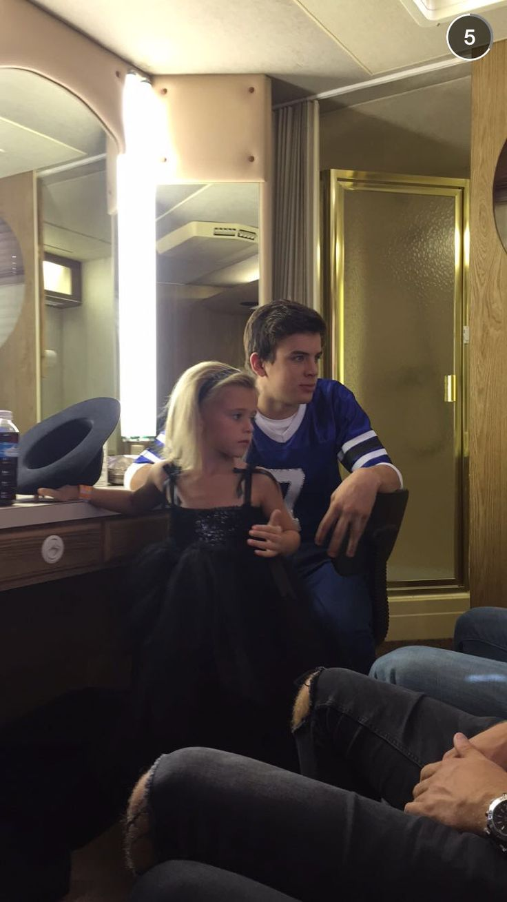 hayes grier and his younger sister, skylynn, before the show (haha and you can tell that those are Nash's legs)