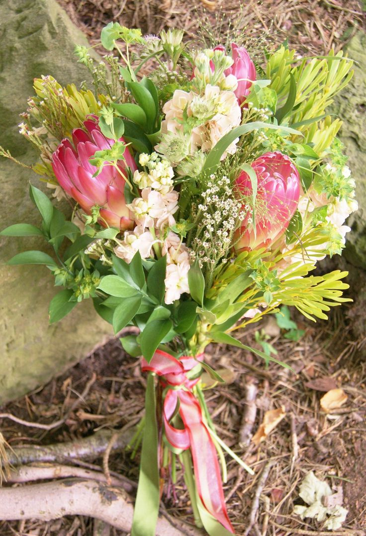 Larger, botanical-style hand-tied bridal bouquet with peachy-blush protea, stock, bupleurum and mixed foliage. Make a style-statement. Florissimo, Shropshire