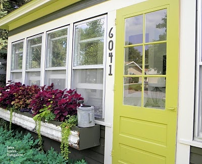 window boxes in front of enclosed front porch