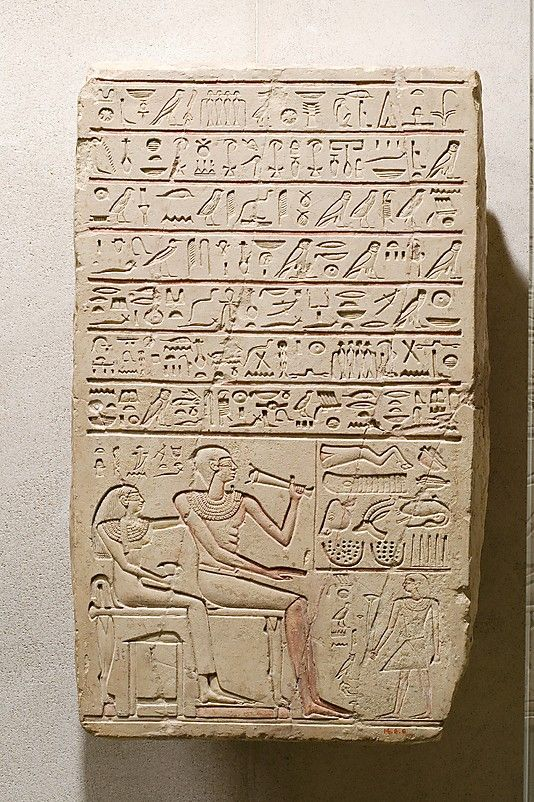 "Funerary stela of ""follower [of the king ?]"" Megegi and his wife Henit-   Period: First Intermediate Period Dynasty: Dynasty 11 Reign: reign of Intef III Date: ca. 2059–2051 B.C. Geography: Country of Origin Egypt, Upper Egypt; Thebes, el-Tarif probably Medium: Limestone, paint"