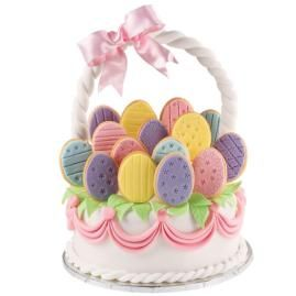 Pure Egg-stravagance! Cake: With all these colorful egg cookies topping a round basket cake, this is Pure Egg-stravagance for your Easter feast! Pipe names or initials on the cookies so everyone can take a personal treat!