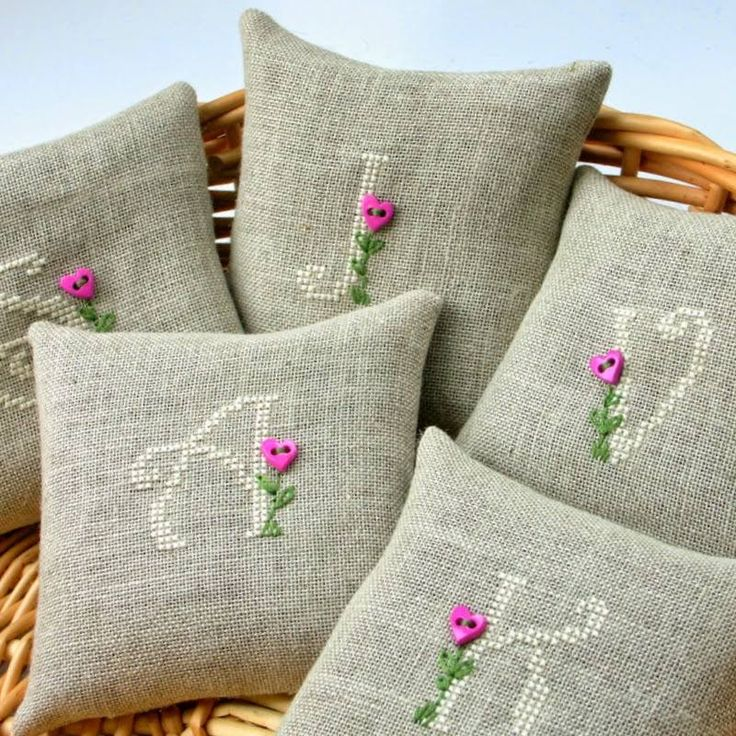 Cross stitched sachets with initials and button flowers
