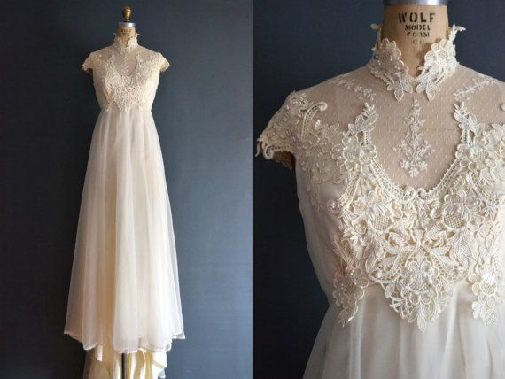 Vintage 70s cream organza wedding dress with lace and beading on high neck collar, illusion bodice, slight empire waist, cap sleeves, and hem.