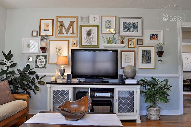 Designing around a television, will do with the plants. Add our photos and initials